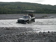 Tour truck crossing the West Fork of the Chulitna River