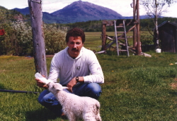 Bottle feeding a baby mountain goat at Telegraph Creek in 1985
