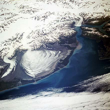 High-altitude aerial photo of the Malaspina Glacier and surrounding region.
