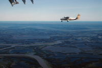 Flying between Inuvik and Tuktoyaktuk in a pair of Twin Otters