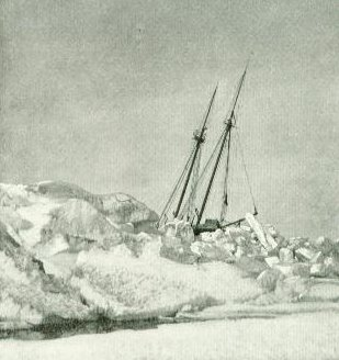 The masts of an old sailing ship sticking out of a jumble of ice