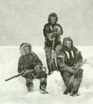 Grizzly looking men sitting on a pile of snow and ice