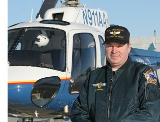 Alaska State Trooper Mel Nading with Helo-1