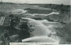 A historic postcard showing gold mining near Atlin, BC