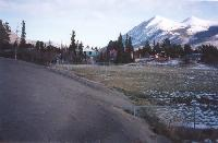 Photo #4 - the active dunes are starting to bury the schoolyard, at Carcross, Yukon