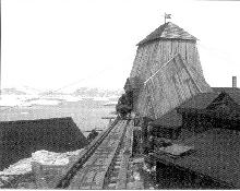 This 1912 photo of the tower over the Josva mine shaft shows a tipping wagon being pushed to the shaft.