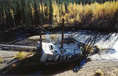 The ruins of the Cowden gold dredge sitting in the Mosquito Fork river, Chicken, Alaska