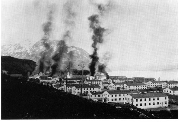 Buildings burning after the first enemy attack on Dutch, Harbor, 3 June 1942.