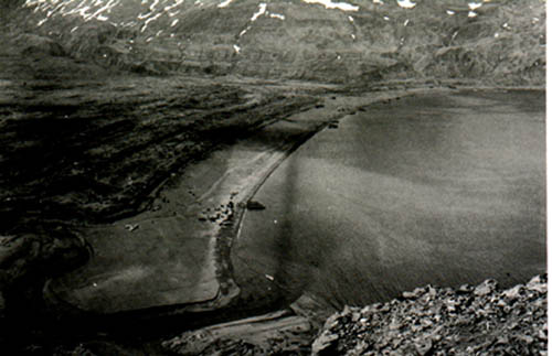The west arm of Holtz Bay viewed from the ridge over which the troops advanced onto Attu. Note the crashed Japanese Zero.