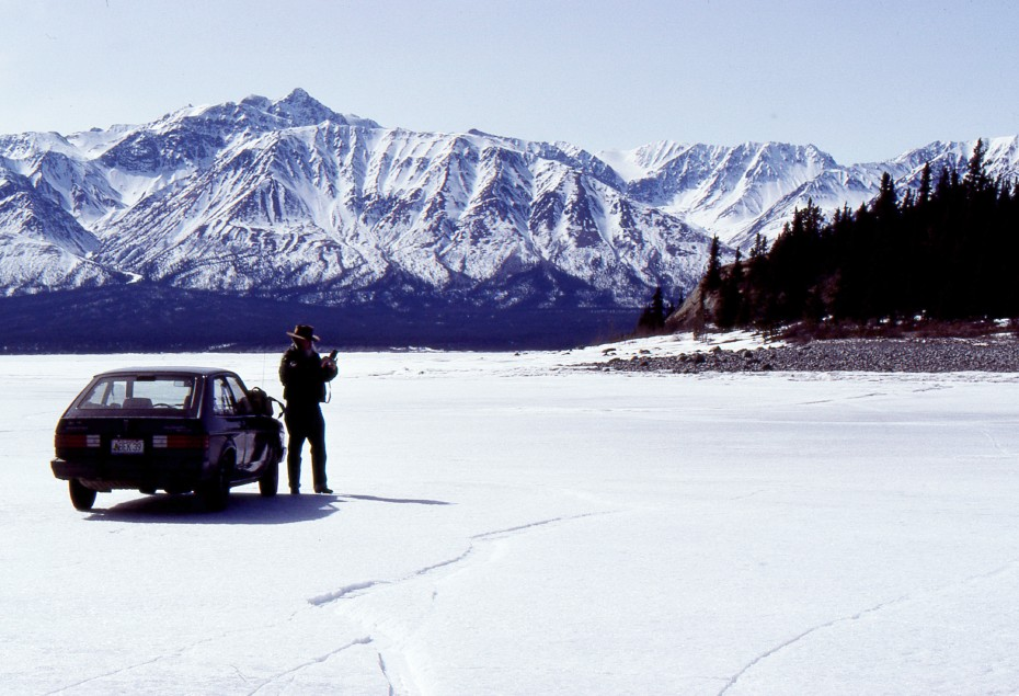 Driving on the ice of Kluane Lake, 6 miles from the nearest road, the Alaska Highway