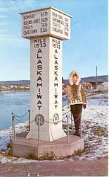 The 'End of the Alaska Highway' sign in Fairbanks, Alaska in the 1960s