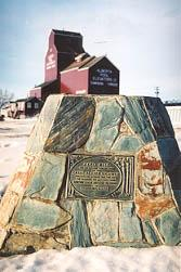 The brass 'Alaska Highway Mile Zero' plaque at NAR Park in Dawson Creek, British Columbia