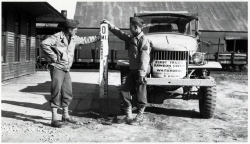 Alaska Highway Mile 0 signpost at Whitehorse, Yukon, in 1943