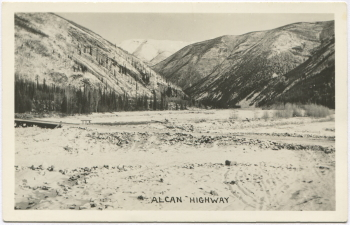 Alaska Highway postcard showing the road in the Muncho Lake area in the 1940s
