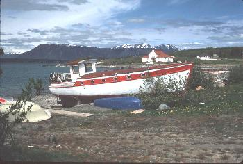 The antique lake boat 'Atlintoo' sits on the beach at Atlin, BC