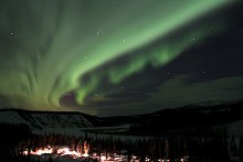 The aurora borealis over the Yukon River near Whitehorse, Yukon