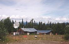 Log cabin at Miner's Junction - the start of the Nahanni Range Road in the Yukon Territory