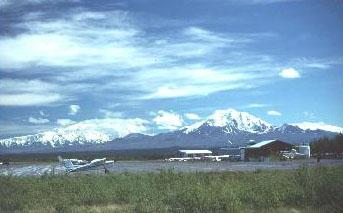 A photo of the Gulkana airstrip, a classic view of bush planes and snowy peaks.