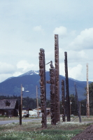 A photo of a line of totem poles in Kitwanaga, BC