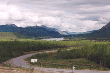 The Alcan Hiway winds along the Liard River near Liard Hot Springs, British Columbia.