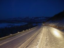 The snowy North Klondike Highway at night