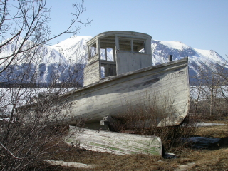 Historic police launch Gladys on the beach at Atlin, BC