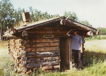 Steven inspects a cozy cabin at Fort Selkirk, along the Yukon River