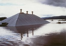 The roof of the Stewart Island Hudson's Bay Company store, caught on a sandbar in the Yukon River