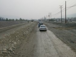Road construction and fire haze near Dawson City