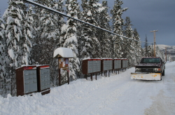 Collecting mail at a country residential subdivision in Whitehorse in the winter